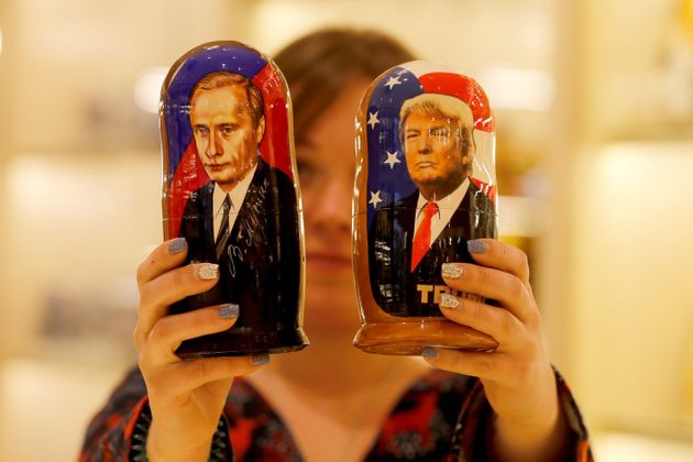 Painted Matryoshka dolls, also known as Russian nesting dolls, bearing the faces of Trump, right,...