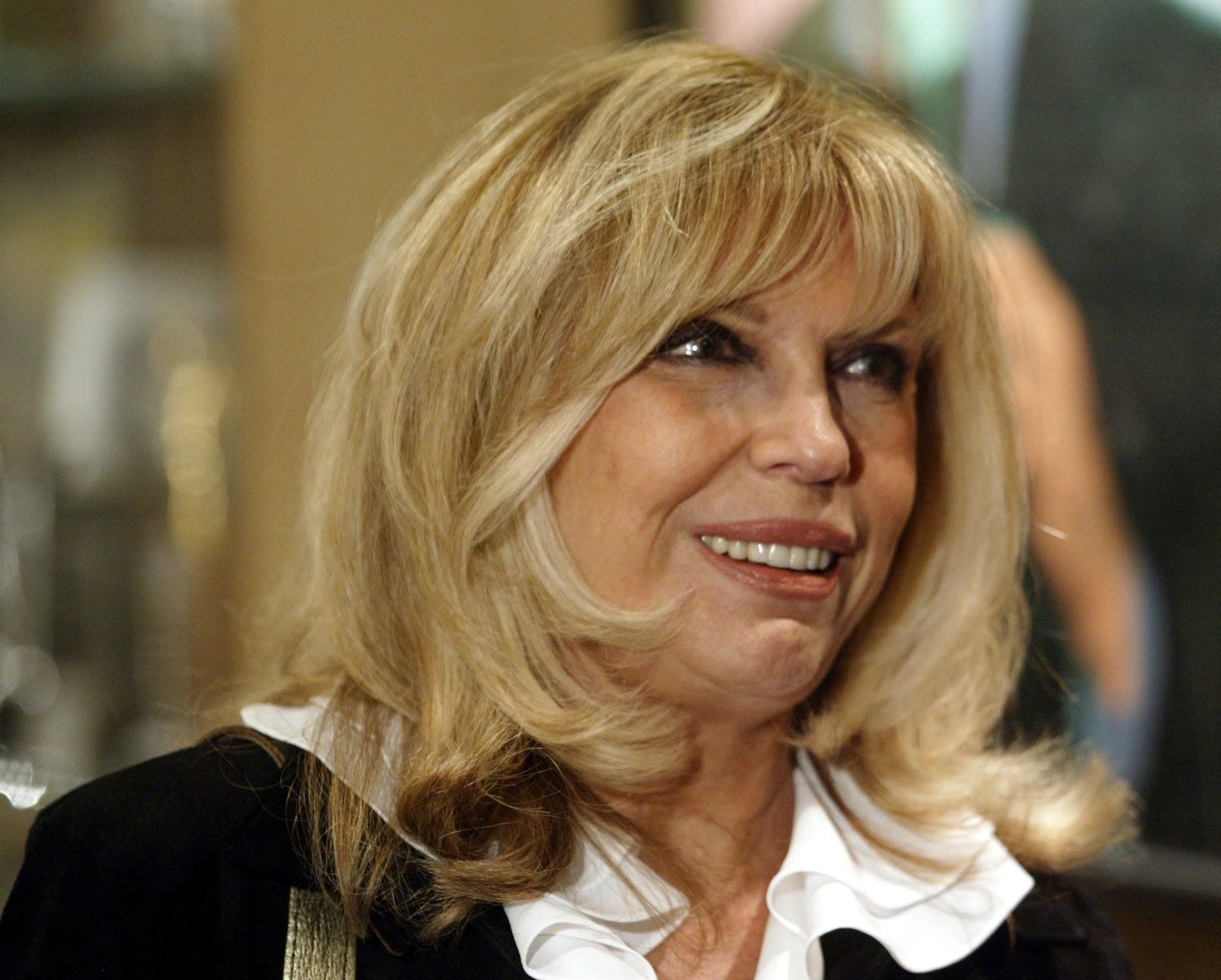 Nancy Sinatra, daughter of the late singer Frank Sinatra is interviewed at the dedication of the Frank Sinatra Hall at the University of Southern California School of Cinema-Television in Los Angeles, November 18, 2002. [Nancy and her sister Tina Sinatra provided memorabilia from their father's life and career which will be on display at the hall until March 2003. Sinatra died May 15, 1998.]