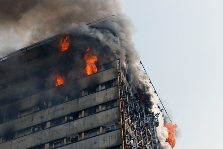 The Plasco building, one of the oldest in Tehran, caught fire on Thursday. Dozens of people were injured.