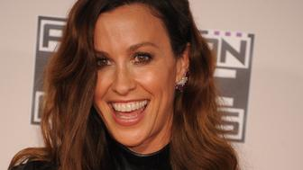 Recording artist Alanis Morissette arrives at the 2015 American Music Awards held at the Microsoft Theater. (Photo by Frank Trapper/Corbis via Getty Images)
