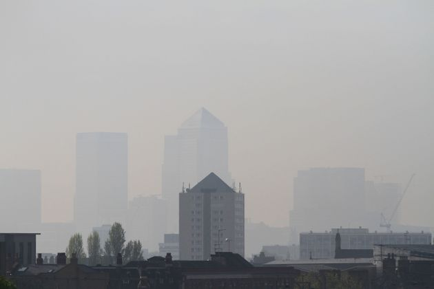 A view of Canary Wharf has become almost invisible showing high pollution level seen from Hackney,