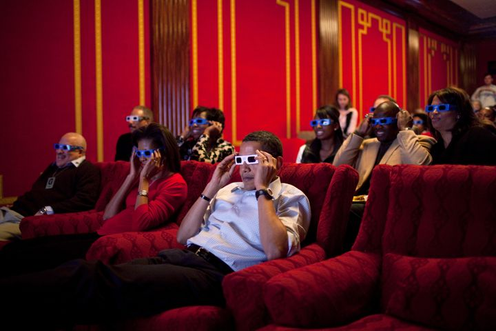 The Obamas wearing 3-D glasses in the family theater of the White House in 2009.