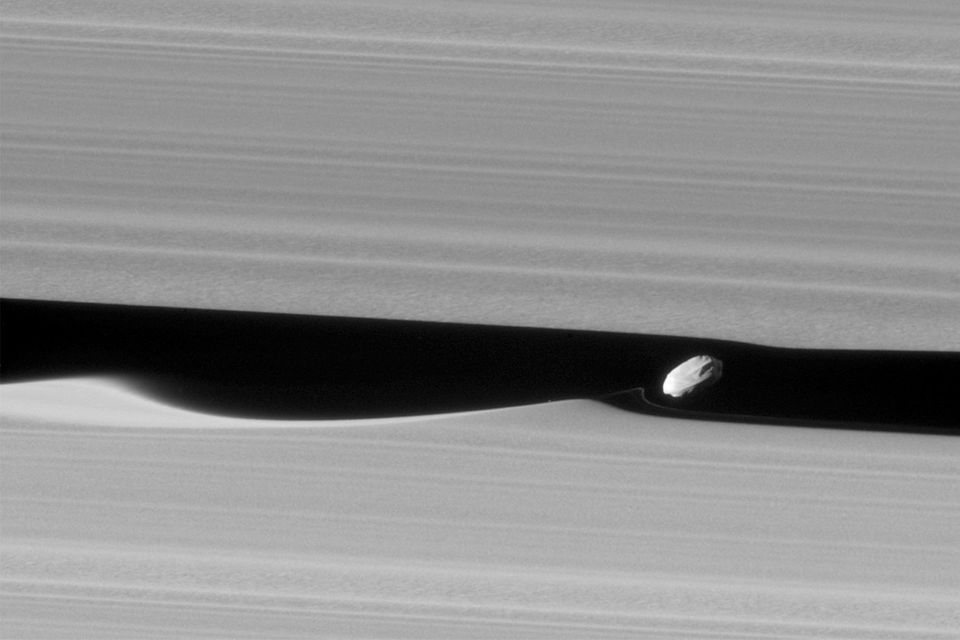 Stunning Picture Shows Tiny Moon Daphnis Surfing The Rings Of