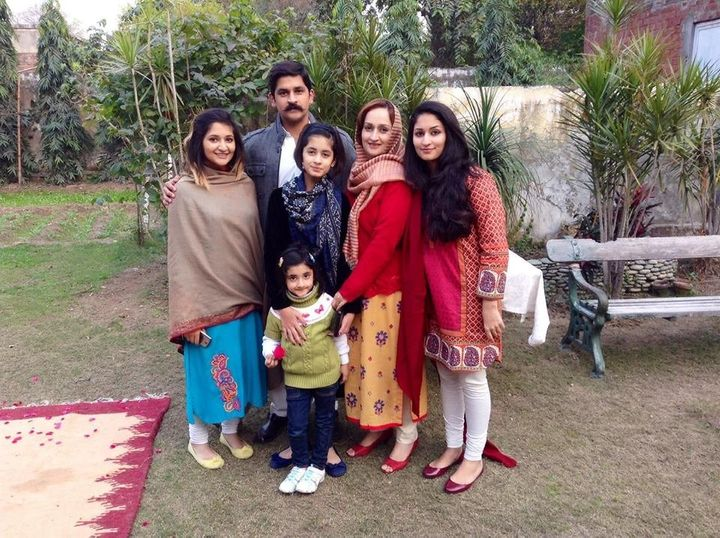 Mahira and her family gather outside their home in Lahore, Pakistan, during Mahira's winter break from university in 2014.