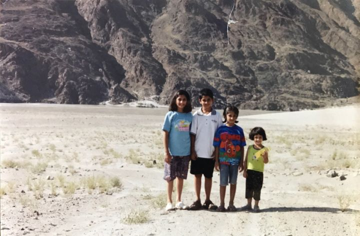 Mahira and her siblings stand on the Karakoram Highway in northern Pakistan while on their way to the Pakistan-China border d