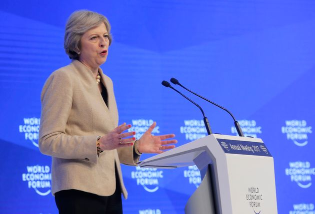 Theresa May said a final Brexit deal would be put to a vote in
