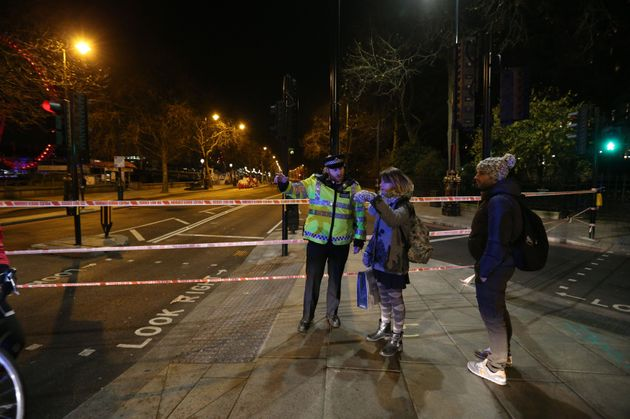 A police cordon on Victoria Embankment, London, as a suspected unexploded Second World War bomb has been...