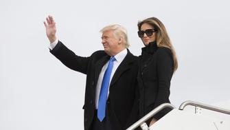 U.S. President-elect Donald Trump and his wife Melania arrive at Joint Base Andrews outside Washington, D.C., U.S., on Thursday, Jan. 19, 2017. The president-elect will participate in a series of pre-inaugural rituals and celebrations, beginning with a reception at the Trump International Hotel he opened in downtown Washington last year. The events are a run-up for his swearing-in at about noon on Friday. Photographer: Chris Kleponis/Pool via Bloomberg
