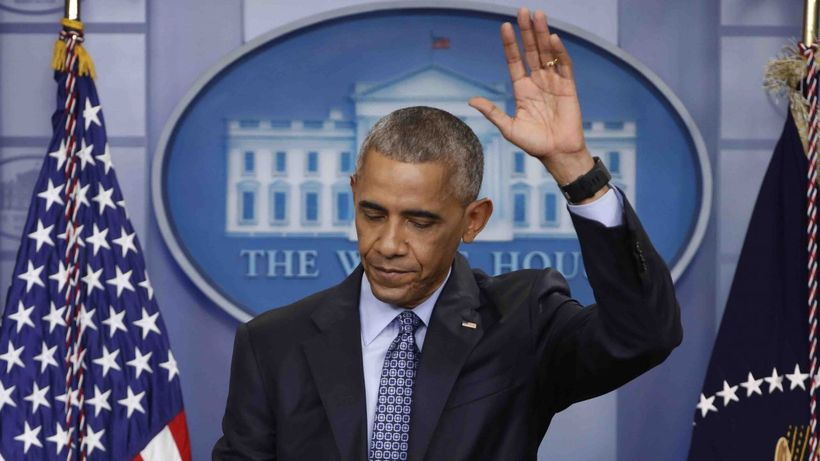 President Obama waves as he concludes his final presidential news conference in the briefing room of the White House on Janua