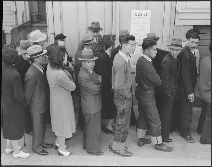 Japanese Americans registering for mass removal in San Francisco, April 1942.