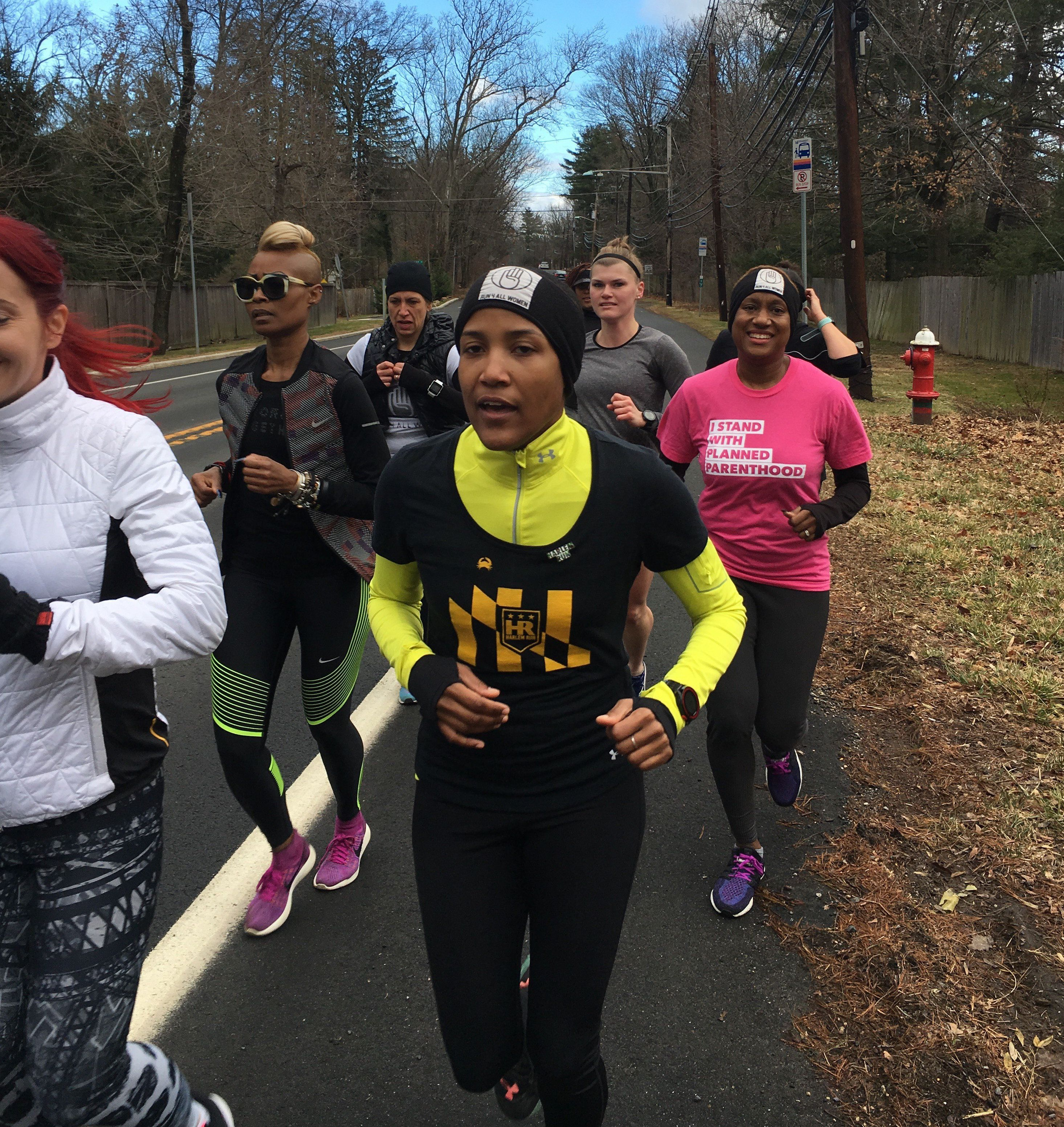 Alison Désir (in yellow) runs part of the 240-mile relay from Harlem New York City, to Washington D.C., that she organized to raise money for Planned Parenthood, January 19, 2017.