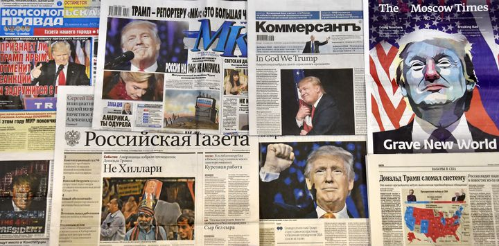This photo illustration taken in Moscow on November 10, 2016 shows front pages of Russian newspapers reporting on the victory