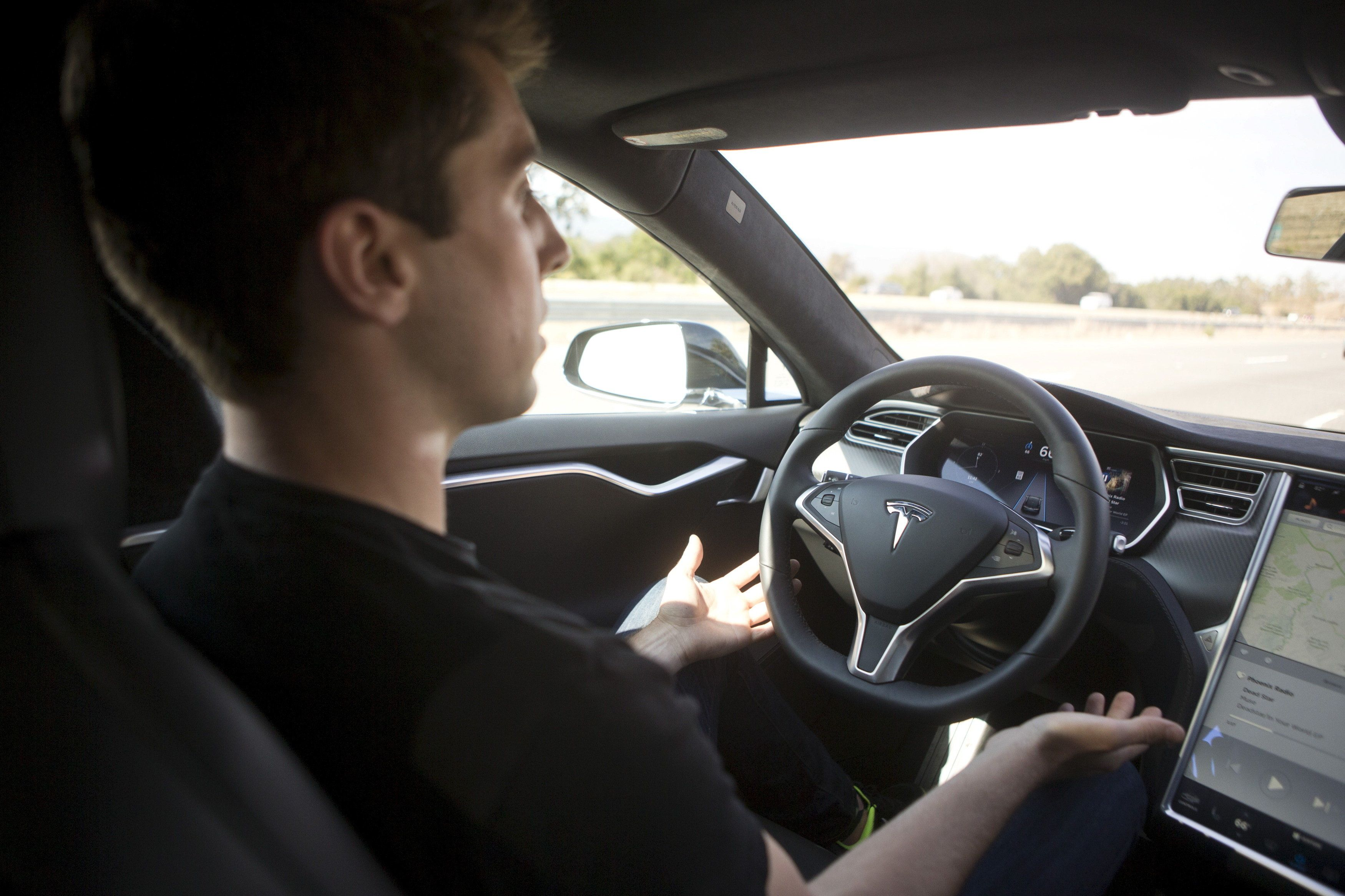 A driver demonstrates Autopilot features in a Tesla Model S in Palo Alto, California, in 2015.