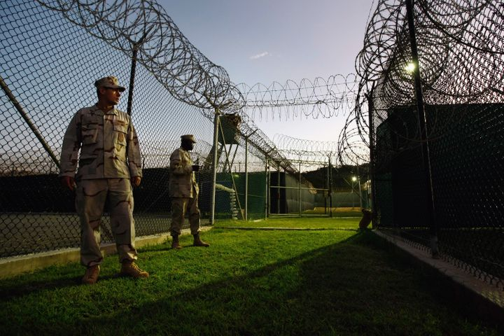 Guards stand outside a Guantanamo camp for Uighur detainees in October 2009.