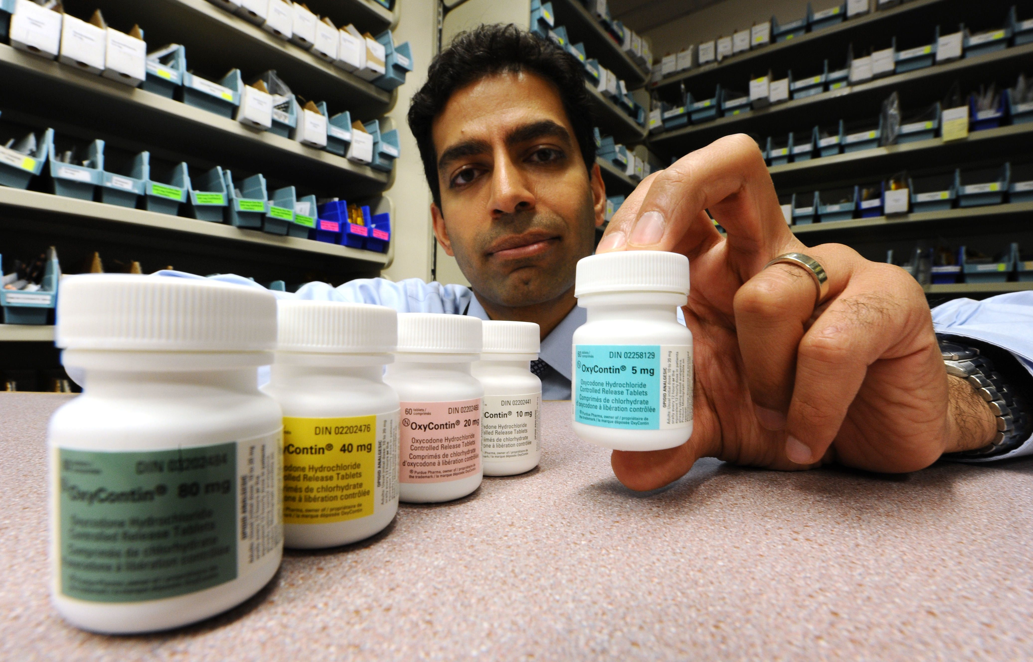 Dr. Irfan Dhalla of St Mike's Hospital (Shown) with five different strengths of Oxycotin in the pharmacy at the hospital.The drug which can be highly addictive is being de-listed here in Ontario and will be replaced with a less addictive drug in the near future.(February2412)RICK EGLINTON/TORONTO STAR. (Photo by Rick Eglinton/Toronto Star via Getty Images)