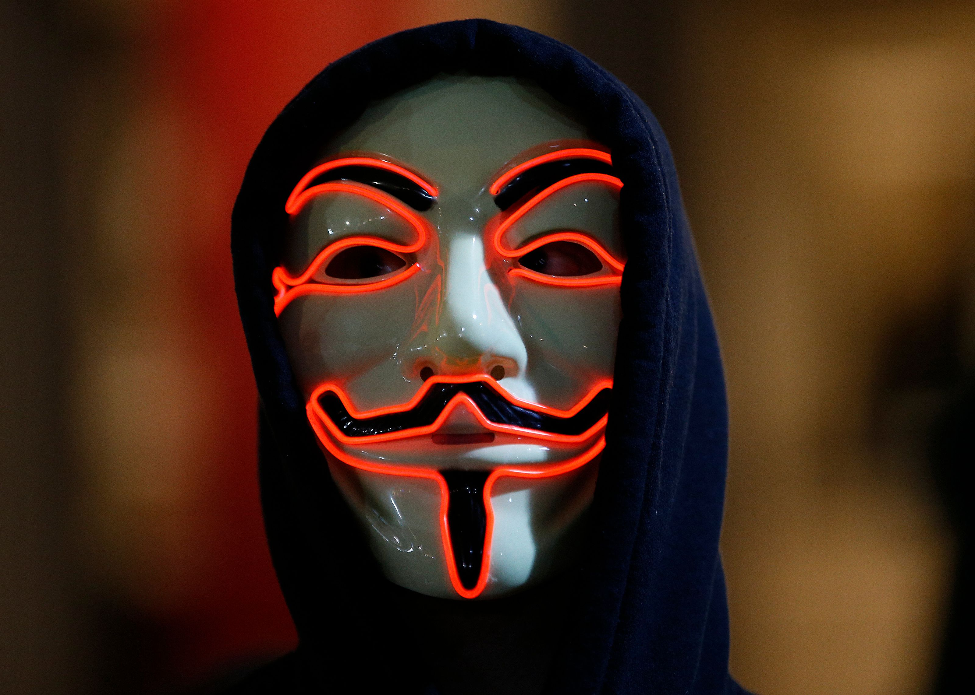 A supporter of the activist group Anonymous wears a mask during a protest in London, Britain November 5, 2015. REUTERS/Peter Nicholls