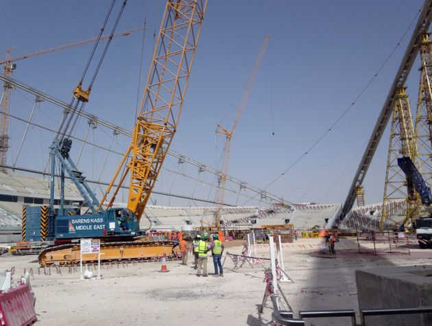 In this 2014 photo, construction work is under way at the Khalifa Stadium in Doha,
