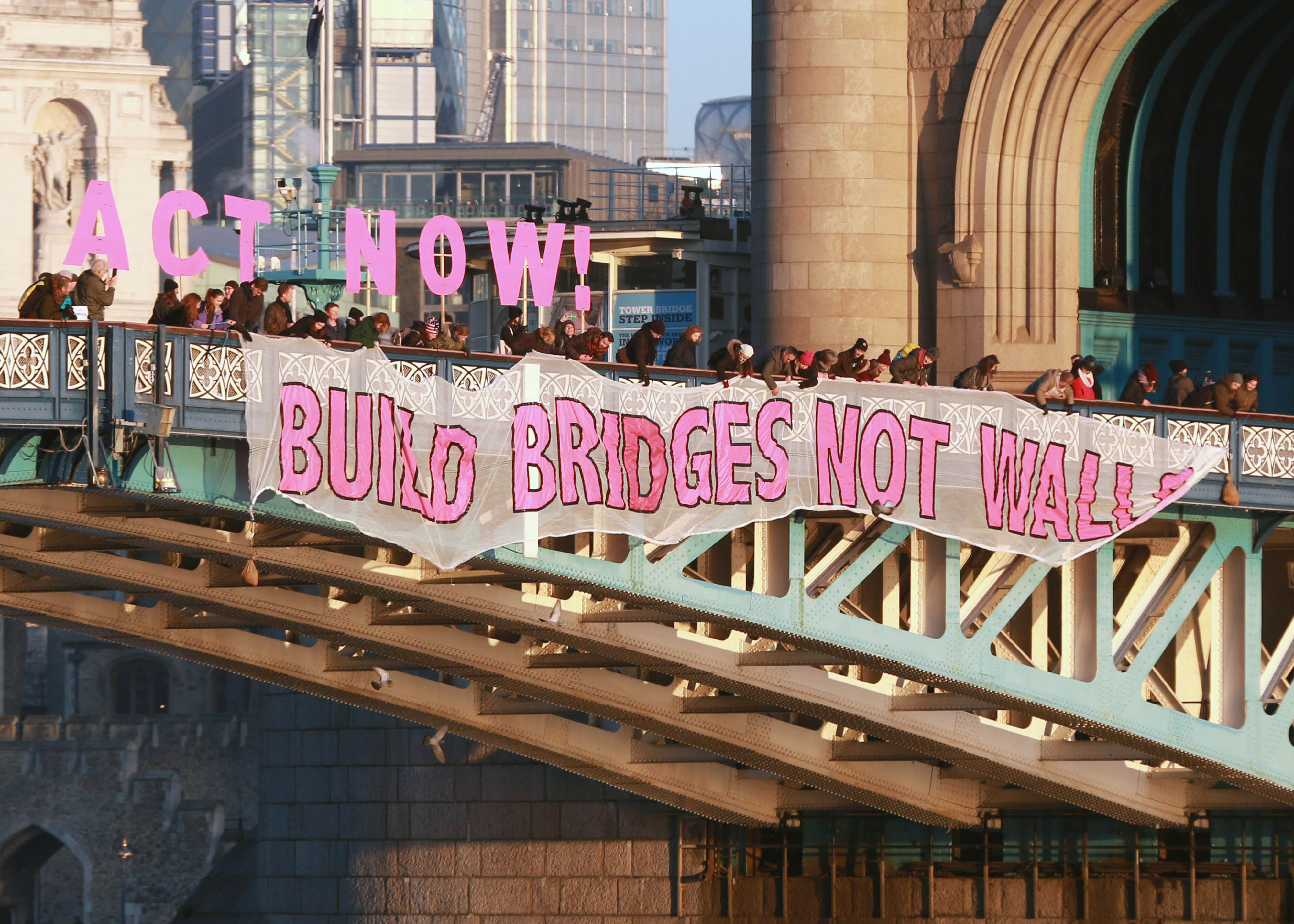 Protesters Defy Donald Trump's 'Politics Of Hate' By Championing 'Bridges Not