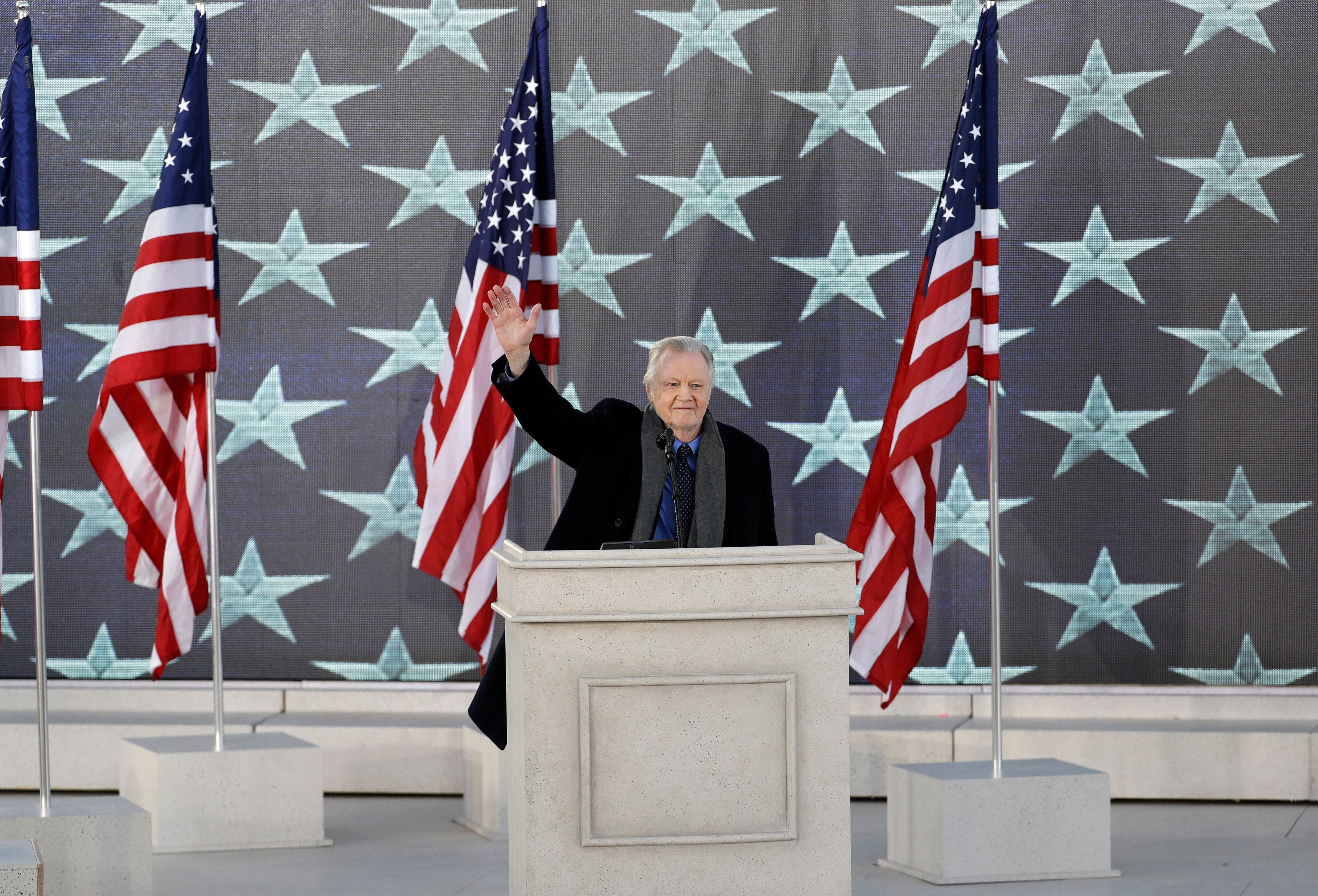 """Jon Voight waves as he appears during a pre-Inaugural """"Make America Great Again! Welcome Celebration"""" at the Lincoln Memorial in Washington, Thursday, Jan. 19, 2017. (AP Photo/David J. Phillip)"""