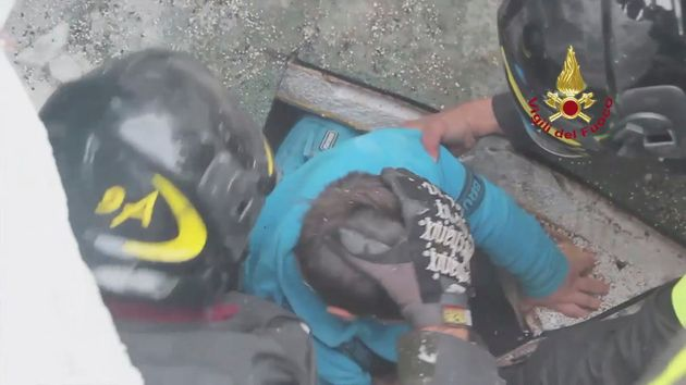 Firefighters rescue a survivor from Hotel Rigopiano in