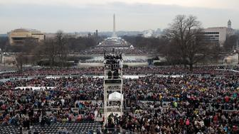 WASHINGTON, DC - JANUARY 20:  Spectators fill the National Mall in front of the U.S. Capitol on January 20, 2017 in Washington, DC. In today's inauguration ceremony Donald J. Trump becomes the 45th president of the United States.  (Photo by Scott Olson/Getty Images)