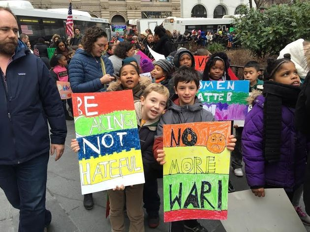 George and Micah, 8-year-old students from PS 261 in Brooklyn, New York, were out protesting hate on