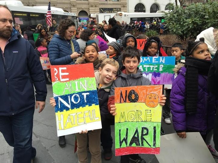 George and Micah, 8-year-old students from PS 261 in Brooklyn, New York, were out protesting hate on Friday.