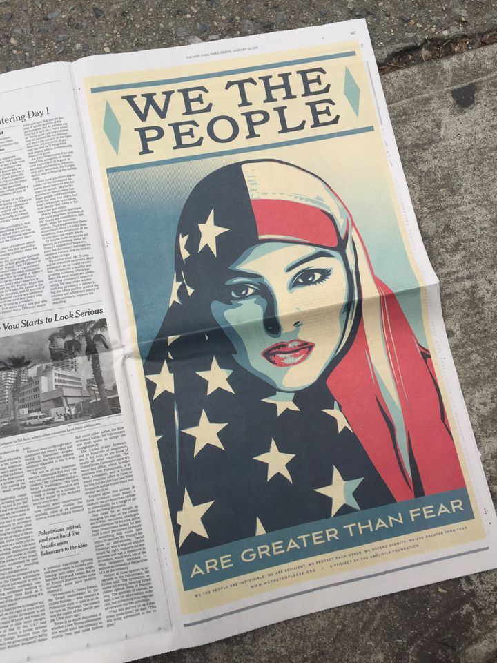 "A photo of Shepard Fairey's ""We The People"" ad in The New York Times."