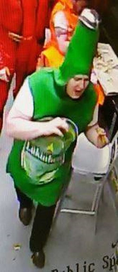 Police in South Wales U.K. are looking for a man accused of stealing two pizzas while dressed as a beer bottle.