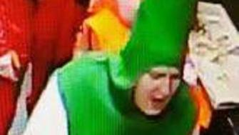 Police in South Wales UK are looking for a man accused of stealing two pizzas while dressed as a beer bottle