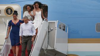 BOURNE, MA - AUGUST 6: President Barack Obama, First Lady Michelle Obama, and their daughters, Sasha (back left) and Malia, step off Air Force One at Joint Base Cape Cod to take Marine One to Martha's Vineyard for a vacation, Aug. 6, 2016. It is Obama's seventh time vacationing on the island as president. (Photo by Timothy Tai for The Boston Globe via Getty Images)