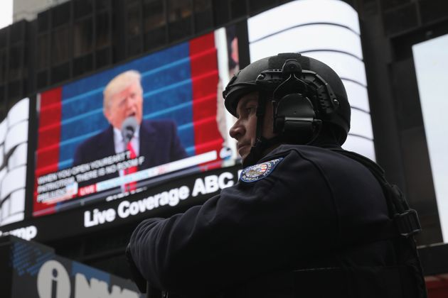 A policeman stands guard during the televised inauguration of Donald Trump as the 45th president of the...