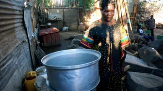 Oyella William makes extra cash by distilling and selling the local spirit siko at home But she often has to suffer harassment from her customers who sit drinking in her backyard all day