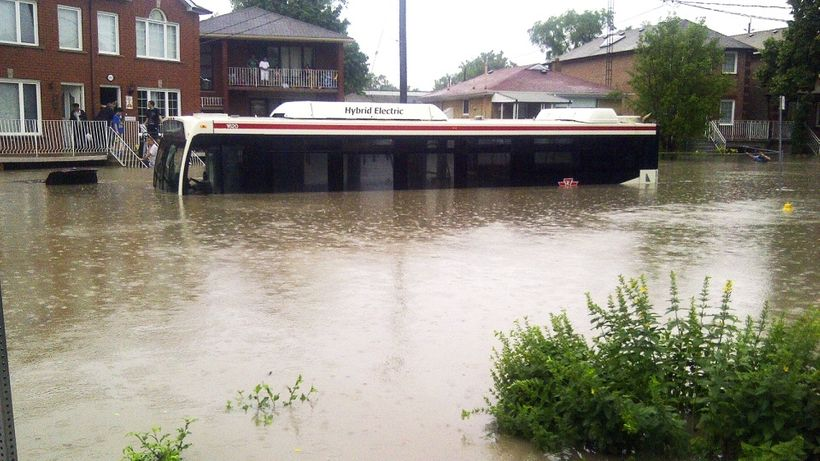 Toronto city bus stuck on a flooded street in the east end of the city.