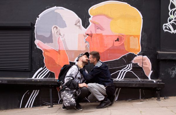 "Trump smooched with Russian President Vladimir Putin in <a href=""https://www.facebook.com/designerBONANU/"" target=""_blan"