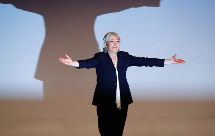 France's National Front leader Marine Le Pen gestures after her speech during a European far-right leaders meeting to discuss