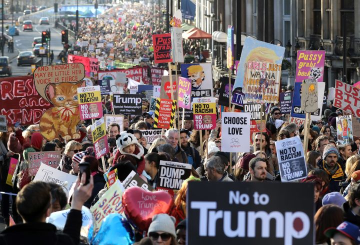 Protesters make their way through the streets of London during the Women's March on Saturday.