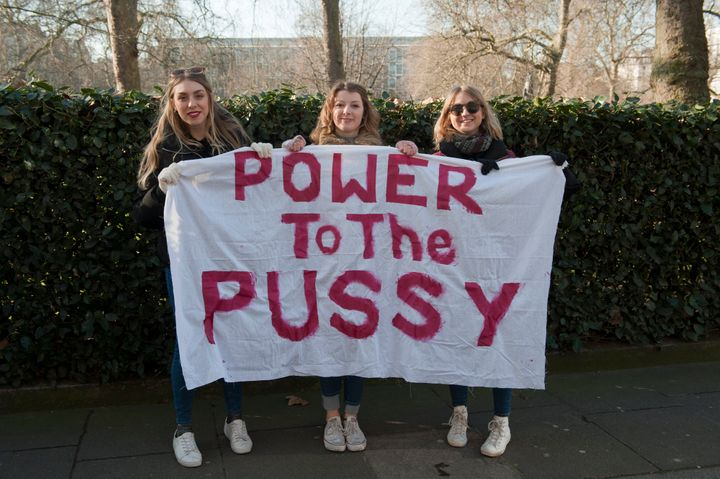 Participants seen during Anti Trump protest on the the first day of Donald Trumps Presidency on January 21, 2017 in London, E