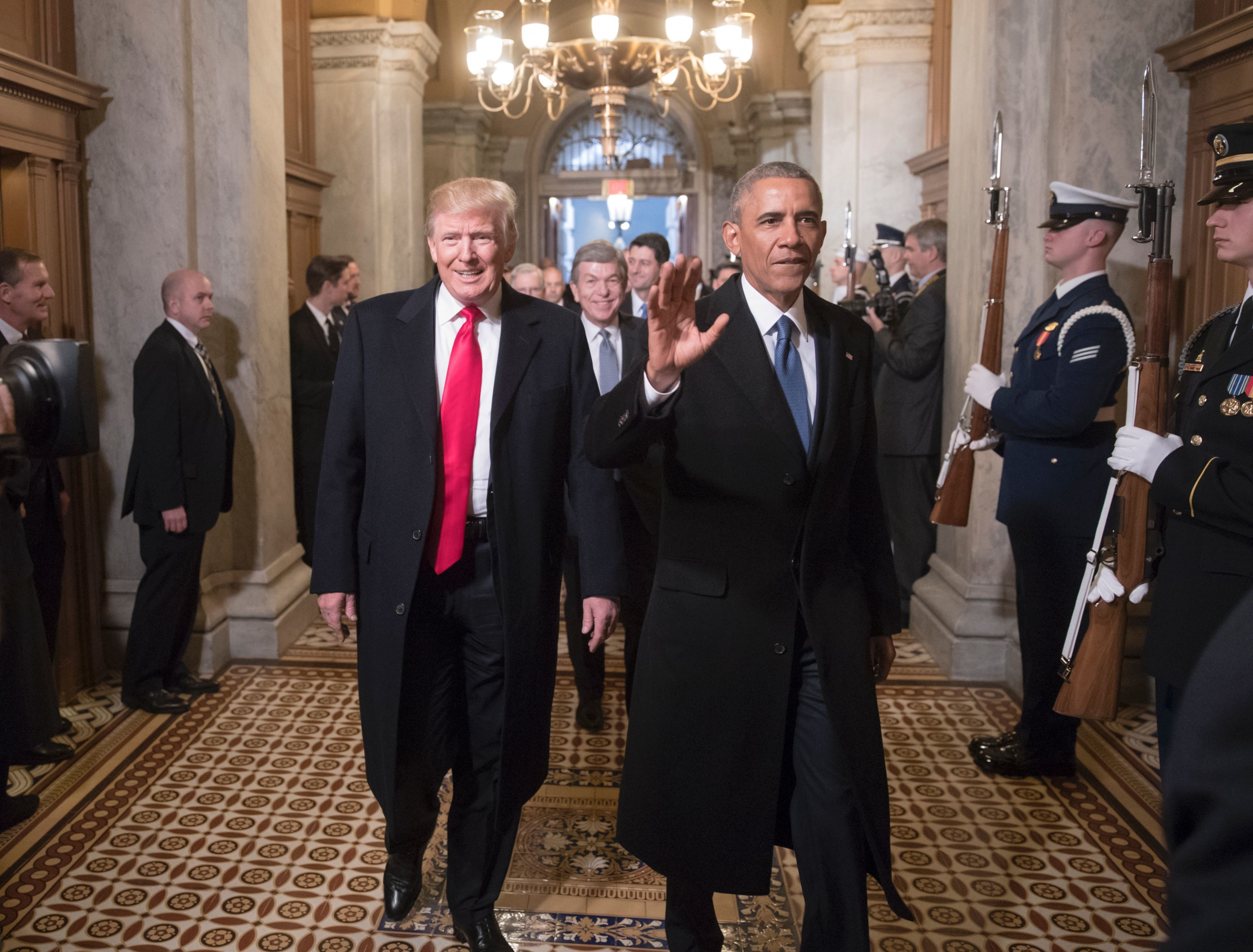 President Donald Trump and former President Barack Obama arrive for Trump's inauguration ceremony on Jan. 20, 2017. Trump kep