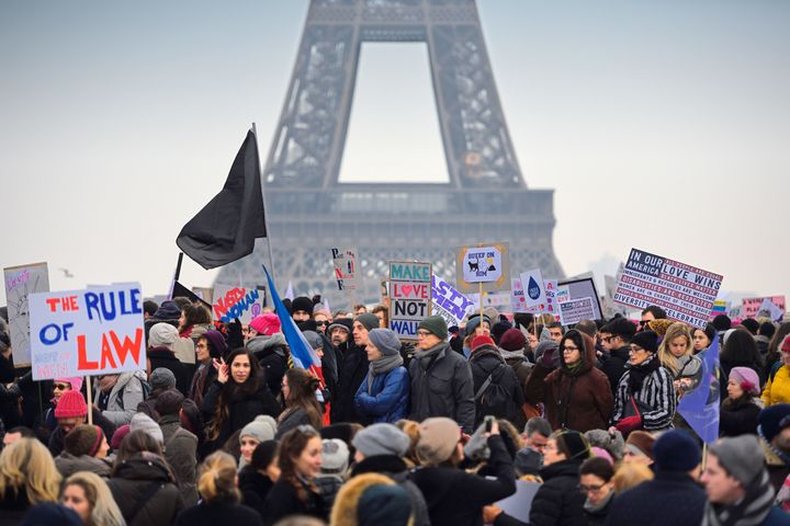Demonstrators carry placards on Saturday in Paris during a rally in solidarity with supporters of the Women's March on W