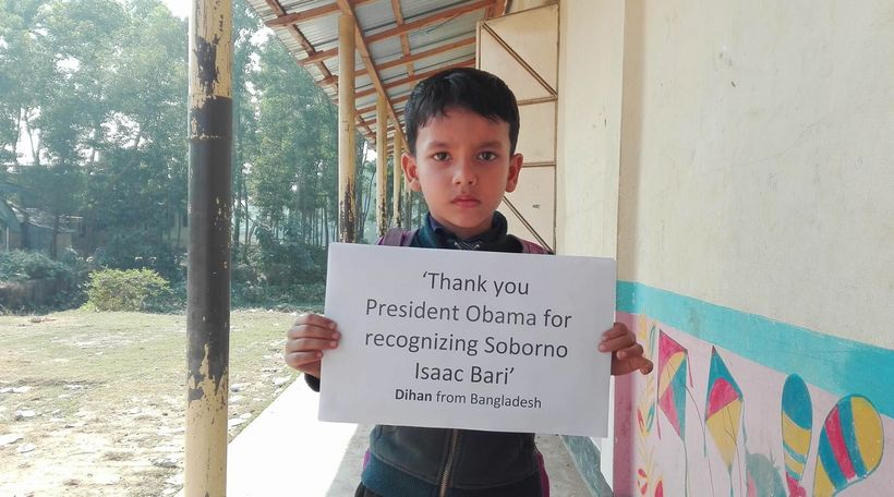 "In this picture, Dihan is promoting the story of President Obama & Soborno Isaac at his school <a rel=""nofollow"" href=""http:/"