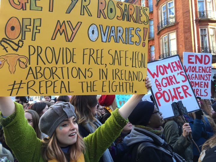 Cara Spelman carried a sign calling for safe and legal access to abortion as she joined thousands of demonstrators at the Lon