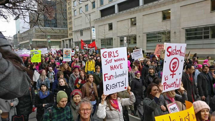 Demonstrators in Toronto make their way to city hall, in a solidarity rally with the Women's March on Washington.