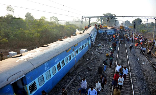 Rescue workers search for victims at the site of the derailment of the Jagdalpur-Bhubaneswar express...