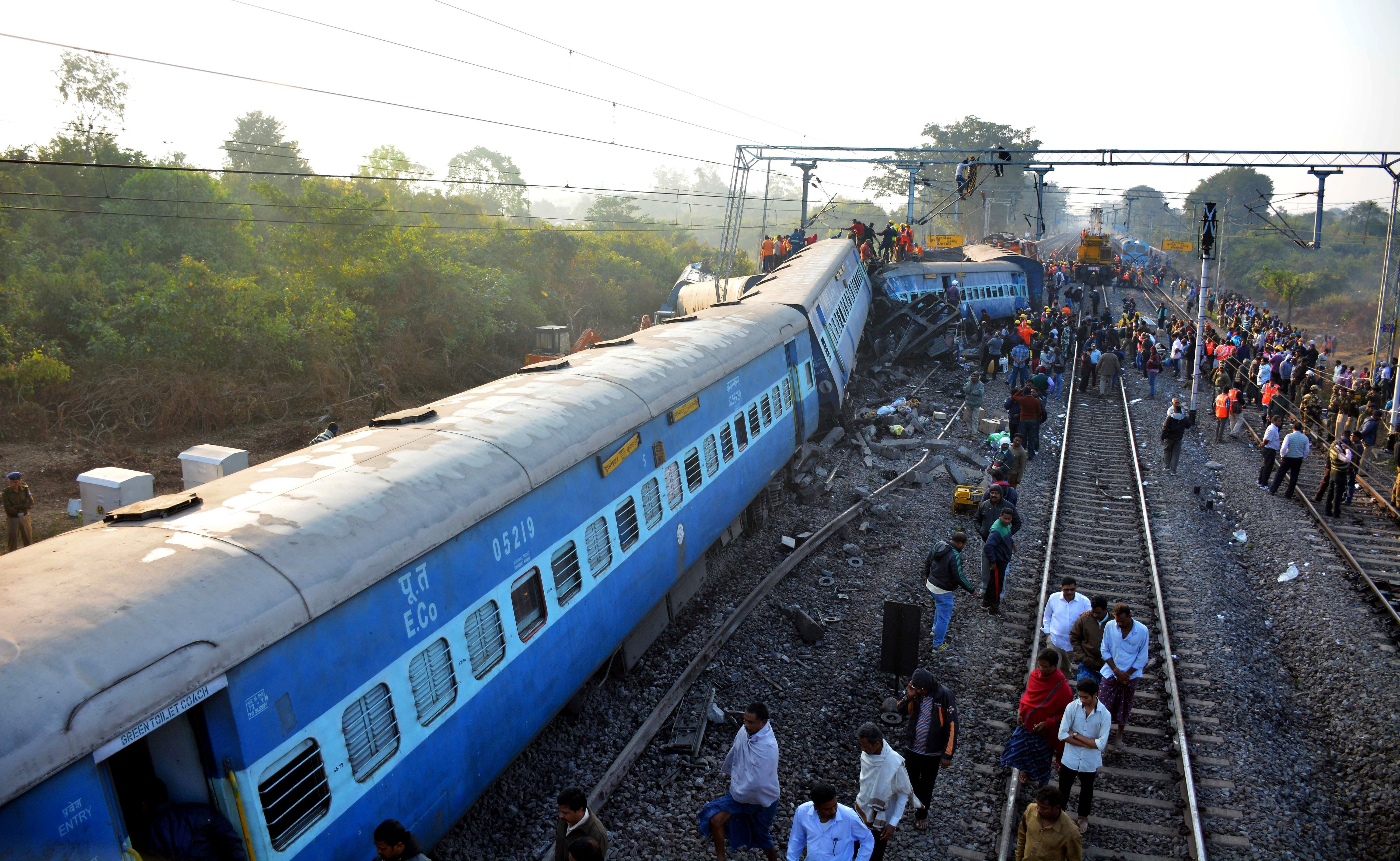 Rescue workers search for victims at the site of the derailment of the Jagdalpur-Bhubaneswar express train near Kuneru statio