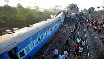 Rescue workers search for victims at the site of the derailment of the Jagdalpur-Bhubaneswar express train near Kuneru station in southern Andhra Pradesh state on January 22, 2017.  Rescuers battled to pull survivors from the wreckage of a train crash which killed 32 passengers in southern India, the latest in a series of disasters on the country's creaking rail network. / AFP / STRINGER        (Photo credit should read STRINGER/AFP/Getty Images)