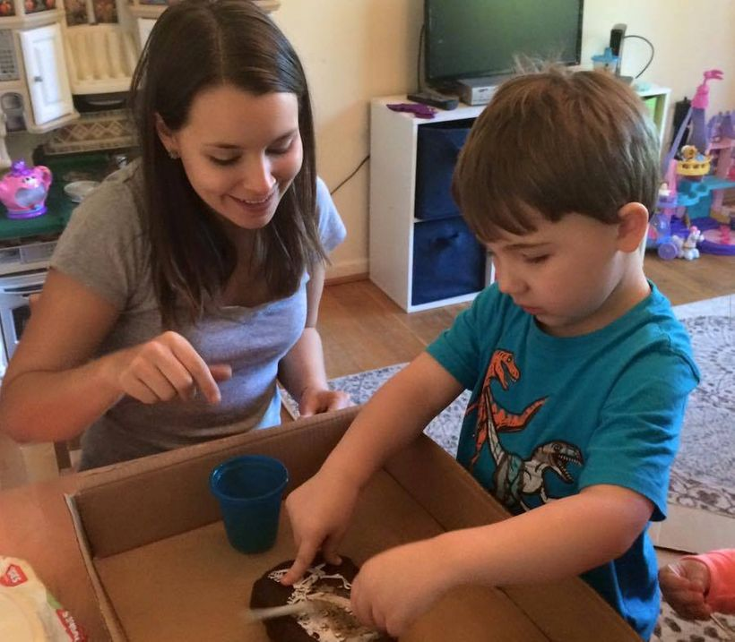 Therapist Anna Giorgianni works on fine motor skills with a military child with autism.