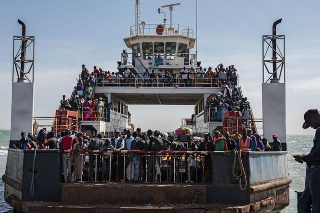 Hundreds of Gambians who had fled the country began returning by ferry from Senegal's Casamance...