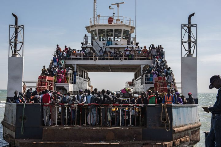 Hundreds of Gambians who had fled the country began returning by ferry from Senegal's Casamance region on Sunday.