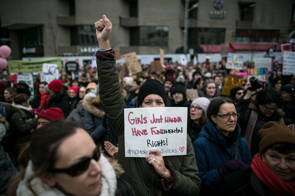 Demonstrators attend the Women's March to protest President Donald Trump, in Montreal, Canada on January 21, 2017. Thousands